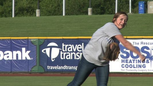 Make-A-Wish teen learns about dream trip while tossing first pitch