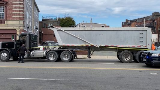 Pedestrian seriously injured after being hit by dump truck in Dorchester