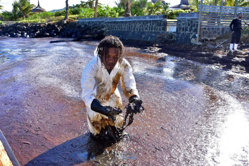 Anxious Mauritians are chopping off their hair to try and stem oil spill