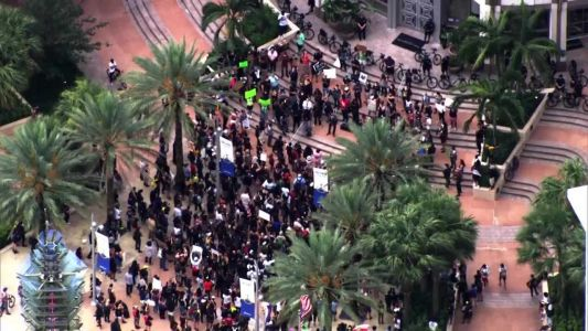 In spite of rain, protesters gather for George Floyd in downtown Orlando