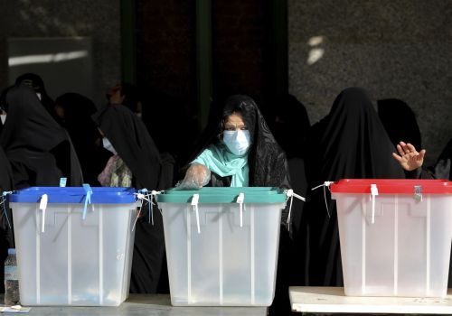 Iran votes in presidential election that appears tipped in hard-liner's favor