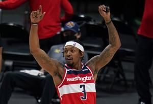 Beal scores 33, Wizards hang on late to beat Nuggets 112-110