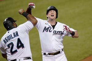 Alfaro homers twice as Marlins beat Red Sox