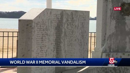 Crews trying various cleaners - without success - on vandalized WWII memorial