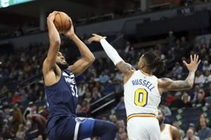 Timberwolves outlast Russell, Warriors, 125-119 in OT