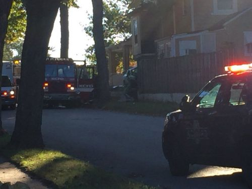 KC home catches fire after car crashes into it Tuesday morning