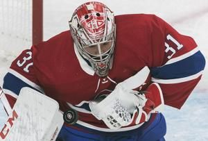 Bernier makes 42 saves, Red Wings beat Canadiens 2-1