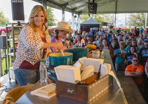 Trisha Yearwood is throwing a giant tailgate party before husband Garth Brook's concert on May 18