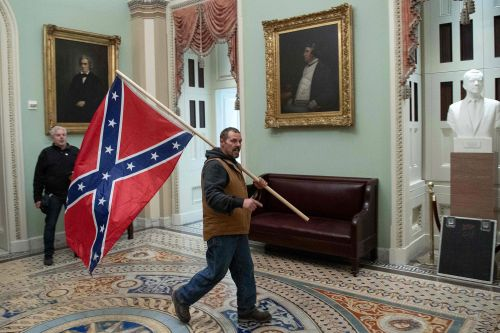 Confederate flag-waving Capitol rioter and son arrested by feds