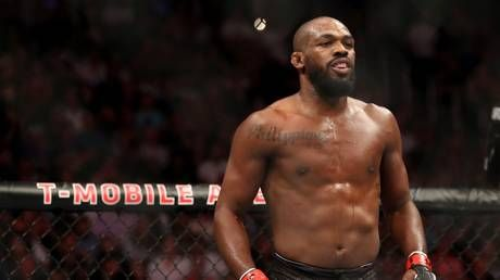 UFC champ Jon Jones charged with battery after 'placing waitress in chokehold at strip club'