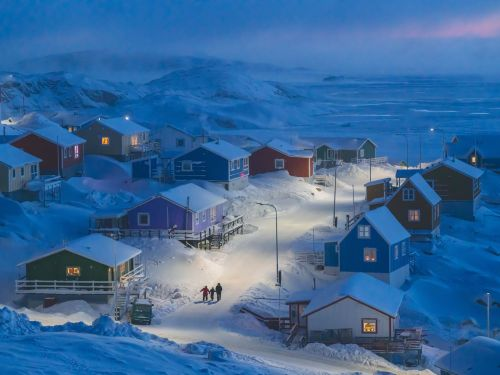The winner of this year's National Geographic Travel Photo Contest is a picture of a tiny village in Greenland where the building colors signify their function