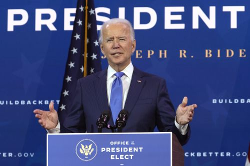 Biden unveils economic team including Yellen, embattled OMB pick Tanden