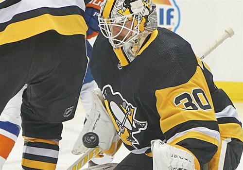 Penguins squander two-goal lead and lose to Islanders in overtime