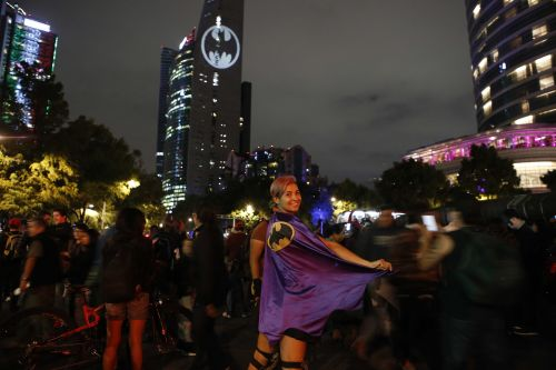 Cities across the world flash the Bat Signal on Batman Day