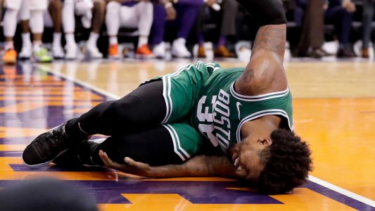Smart leaves game with ankle injury in Celtics win over Suns