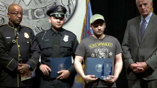 Milwaukee police give Merit Award to man who saved officer's life
