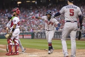 Braves clinch playoff spot behind Acuña Jr