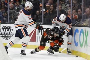 Ducks down Oilers in OT behind Milano's 2-goal debut