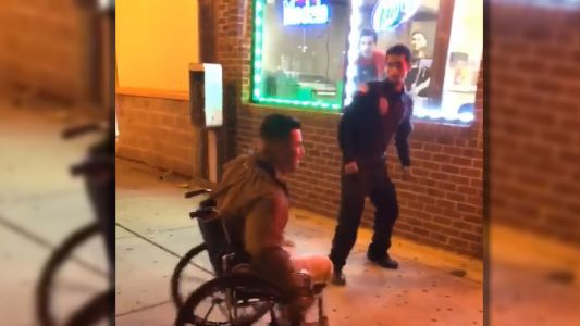 Video shows security guards punch, kick wheelchair-bound man