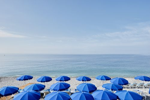Official: Woman impaled in the chest by beach umbrella