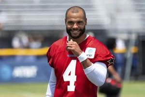 Cowboys' Prescott takes next step since injury as camp opens