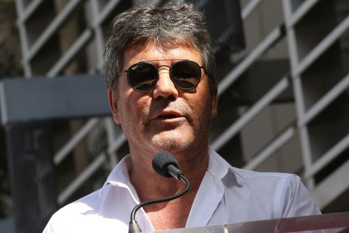 Simon Cowell's friends concerned after wedding no-show
