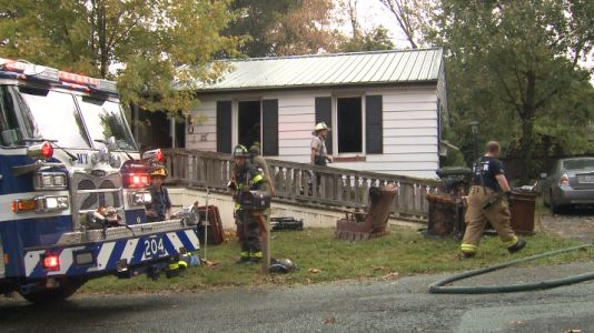 'We have to go': Woman rescues neighbor from burning home
