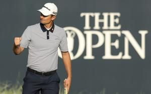 The Latest: Spieth moves to top of leaderboard with 65
