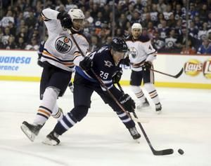 McDavid has 4 points, Nurse scores in OT as Oilers top Jets