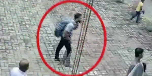 Video shows backpack-wearing Sri Lanka suicide bombing suspect walking into Easter church service seconds before a blast killed 110 people