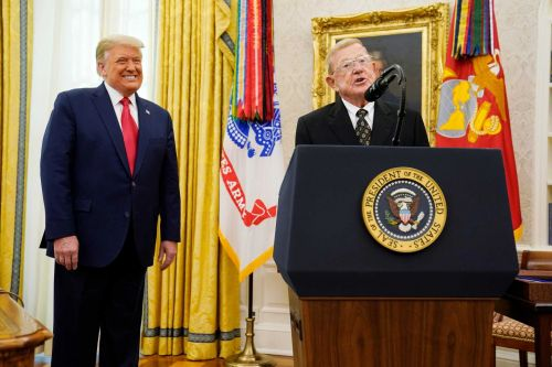 President Trump honors football coach Lou Holtz as 'one of the greatest'
