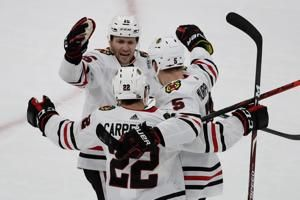 Blackhawks, recover, beat Bruins 4-3 in OT