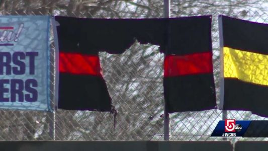 Overpass flags on Mass. highway honoring first responders vandalized