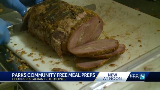 Group busy cooking annual meal for those in need