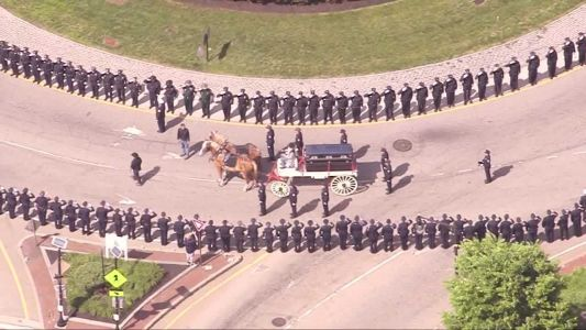 Horse-drawn carriage brings fallen Worcester officer to funeral mass