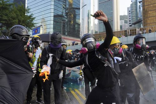 Violence flares after protest march in Hong Kong