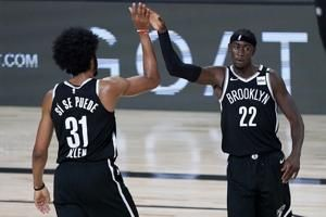 Minus stars, Nets clinch playoff spot in victory over Kings