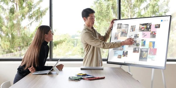 Microsoft unveiled a $9,000 battery-powered 50-inch touchscreen TV with a computer inside that can be rolled around the office on a cart