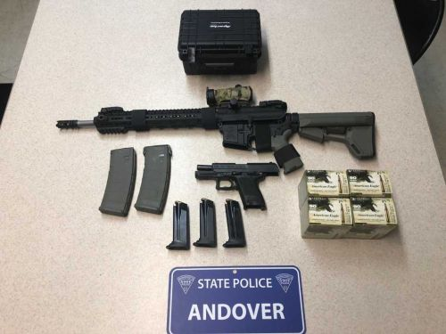 Man accused of brandishing gun at driver arrested on weapons charges