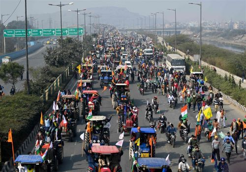 Tens of thousands of angry farmers drive tractors into New Delhi in protest