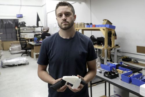 3-D printed gun firm owner accused of paying for underage sex