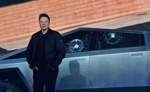 During unveiling of Tesla's 'bulletproof' electric pickup, metal ball cracks unbreakable windows