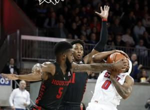 No. 21 Houston leads throughout in 69-58 win at SMU