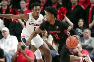 Jarreau, Mills lead No. 25 Houston past UConn 63-59