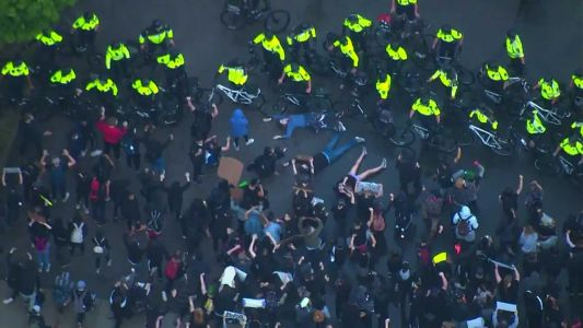 Protesters stage 'die-in' protest outside Boston police station