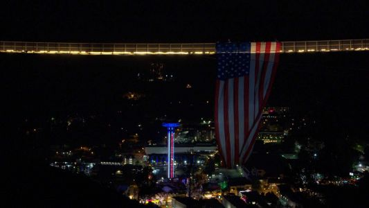 American flag hanging from iconic pedestrian bridge