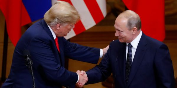 Standing next to Putin, Trump just publicly backed Russia over the US intelligence community on the Kremlin's election meddling
