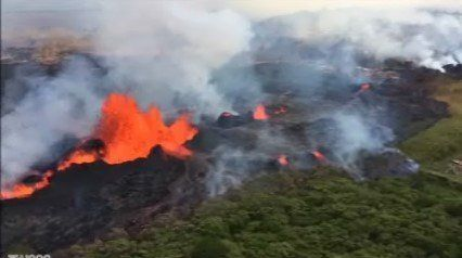 Lava paths in Hawaii merge to create two lines into the Pacific Ocean