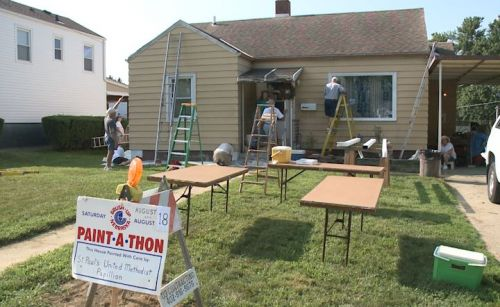 """""""These are my angels"""": Volunteers paint dozens of houses at no cost to homeowners"""