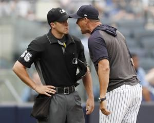 Yankees manager Aaron Boone suspended a game for umpire rant